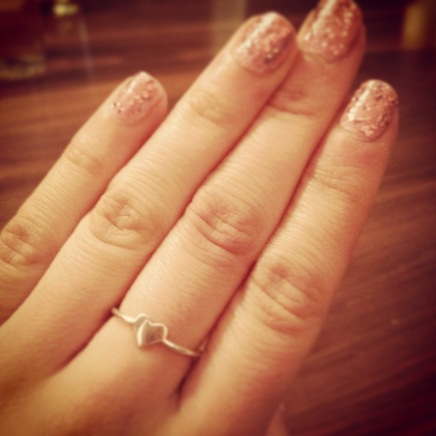 A pink sparkly manicure and my new heart ring gifted from my sister